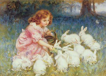 tanti coniglietti bianchi nel prato